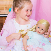 Girl holding baby doll