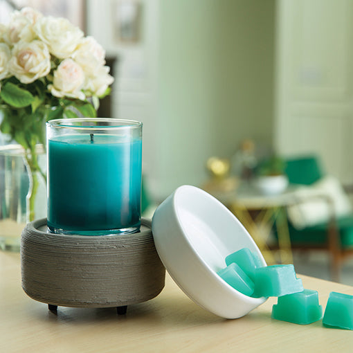 Wax melter with candle