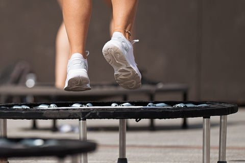 Close-up of woman jumping on mini-trampoline
