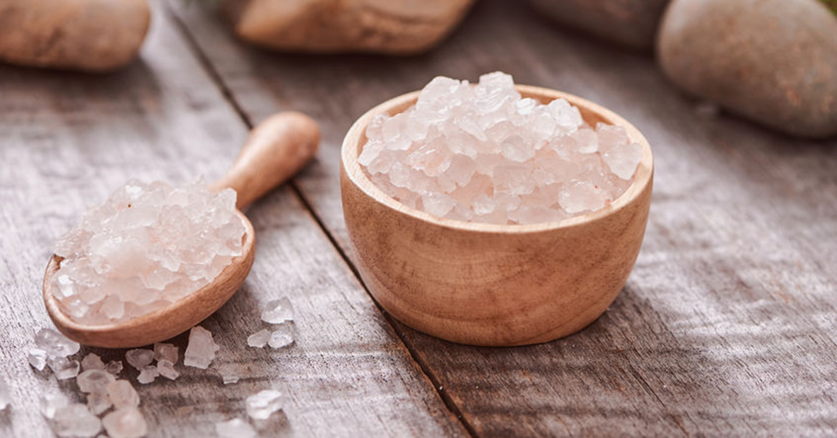 Himalayan Sea Salt in wooden bowl with scoop.
