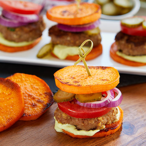 Bun-less turkey burgers with sweet potatoes, tomatoes, and onions.