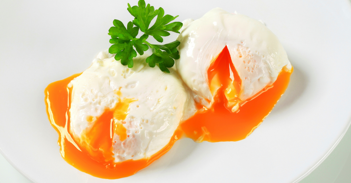 Two poached eggs with parsley.