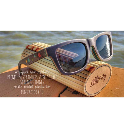 maple wood skateboard sunglasses sitting on case