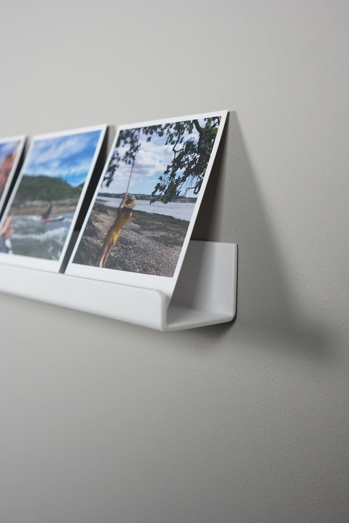 polaroid picture shelving white