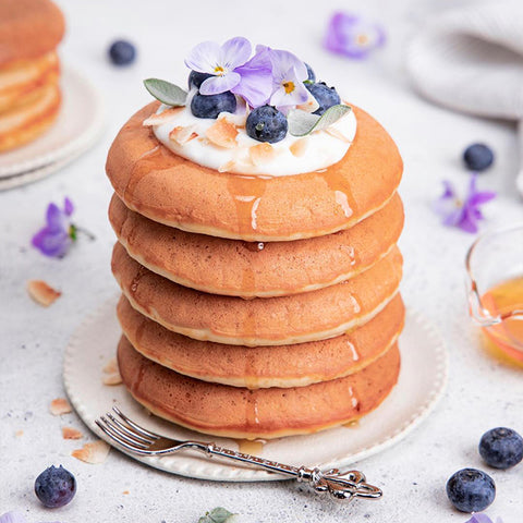 Super Fluffy Spelt Pancakes Topped with Toasted Coconut Chips