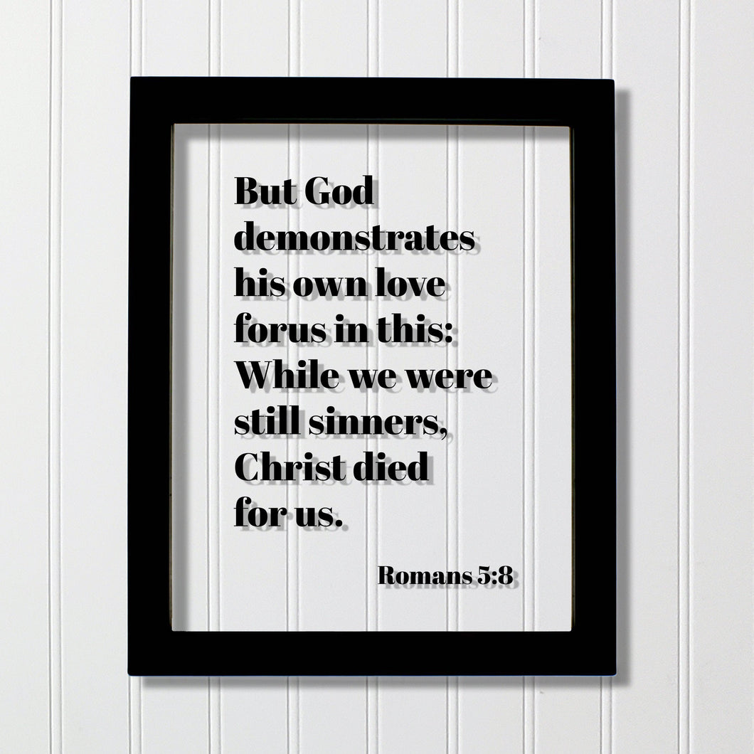 Romans 5:8 - But God demonstrates his own love for us in this While we were still sinners Christ died for us - Scripture Frame - Bible Verse