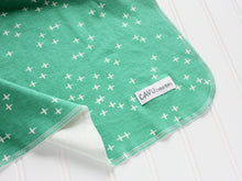 Plus Signs (Wink) Organic Swaddling Blanket - White / Green - CAVU Creations