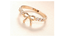Simple Fashion Imitation Crystal Bow Ring For Women (Resizable)