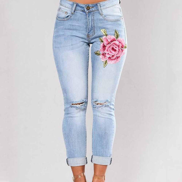 women light blue color with embroidery rose jeans