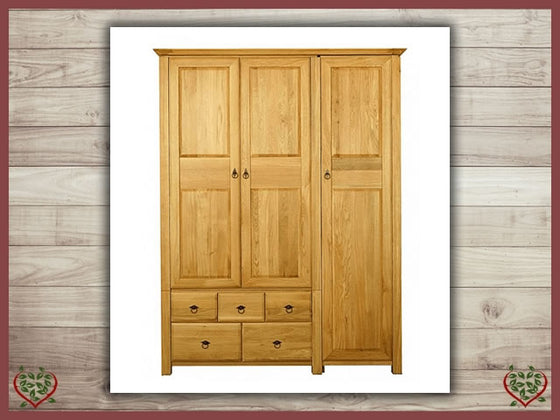 TEMPLE OAK WARDROBE, 3 DOORS AND 5 DRAWERS | Paul Martyn Furniture UK