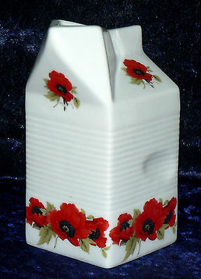 Milk carton shaped jug off white ceramic decorated with  colourful poppies