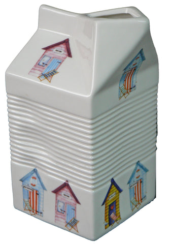 Milk carton shaped jug off white ceramic decorated with colourful beach huts