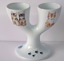 Cats design double egg cups. Porcelain eggcup designed for 2 boiled eggs