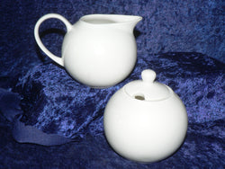 white bone china milk jug and/or sugar bowl