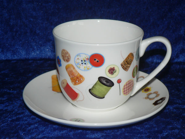 Bone china cup and saucer set decorated with a fun sewing/needlework design