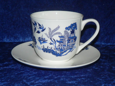 Bone china cup and saucer set decorated with our traditional blue willow pattern design