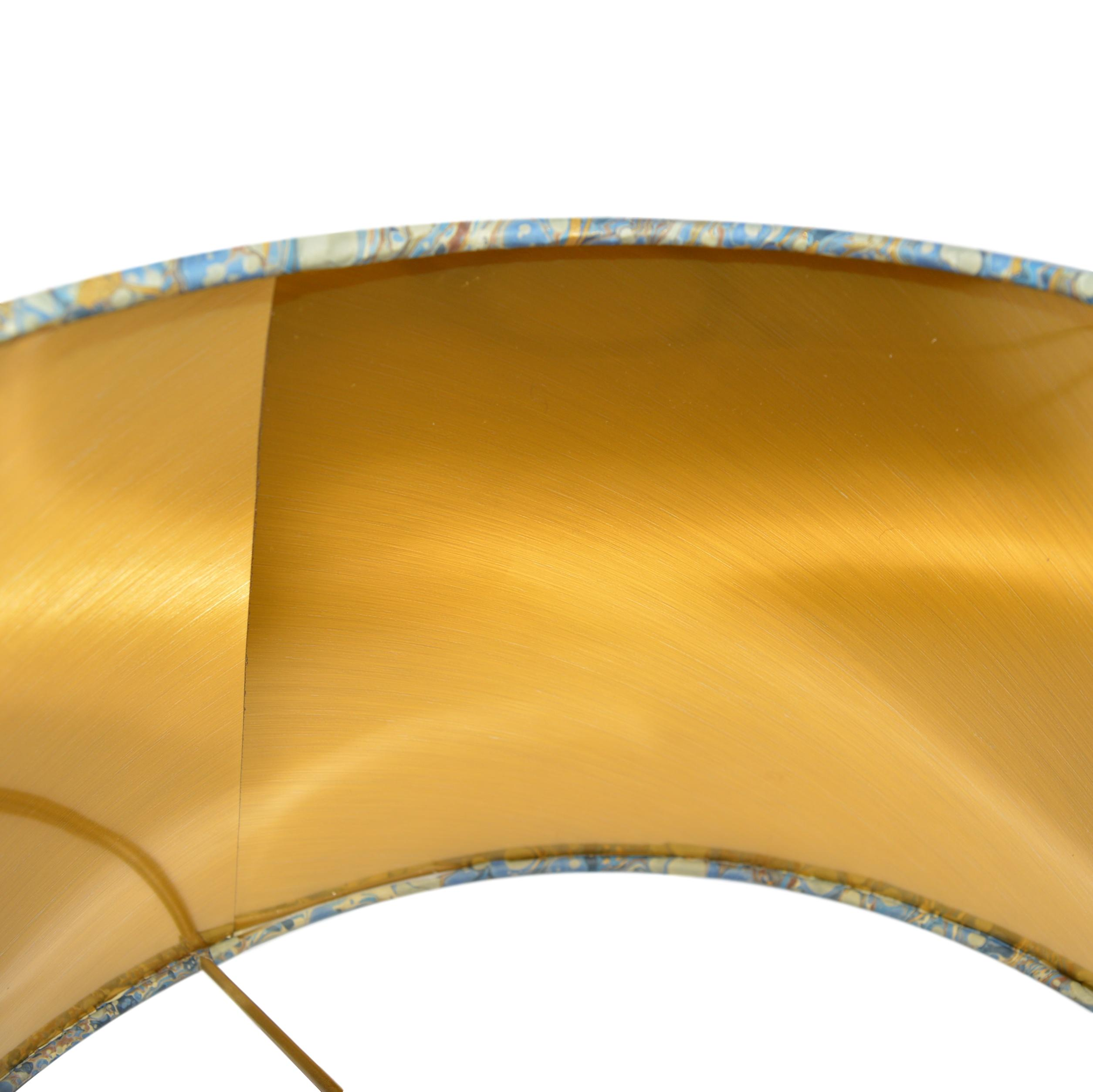 Munro and Kerr blue swirl marbled paper for a handmade tapered drum lampshade with gold lining