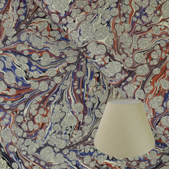 Munro and Kerr terracotta and lavender marbled paper to be used for lampshades