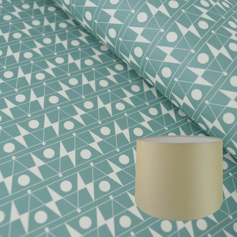 Munro and Kerr duck egg blue printed Esme Winter paper for a tapered drum lampshade