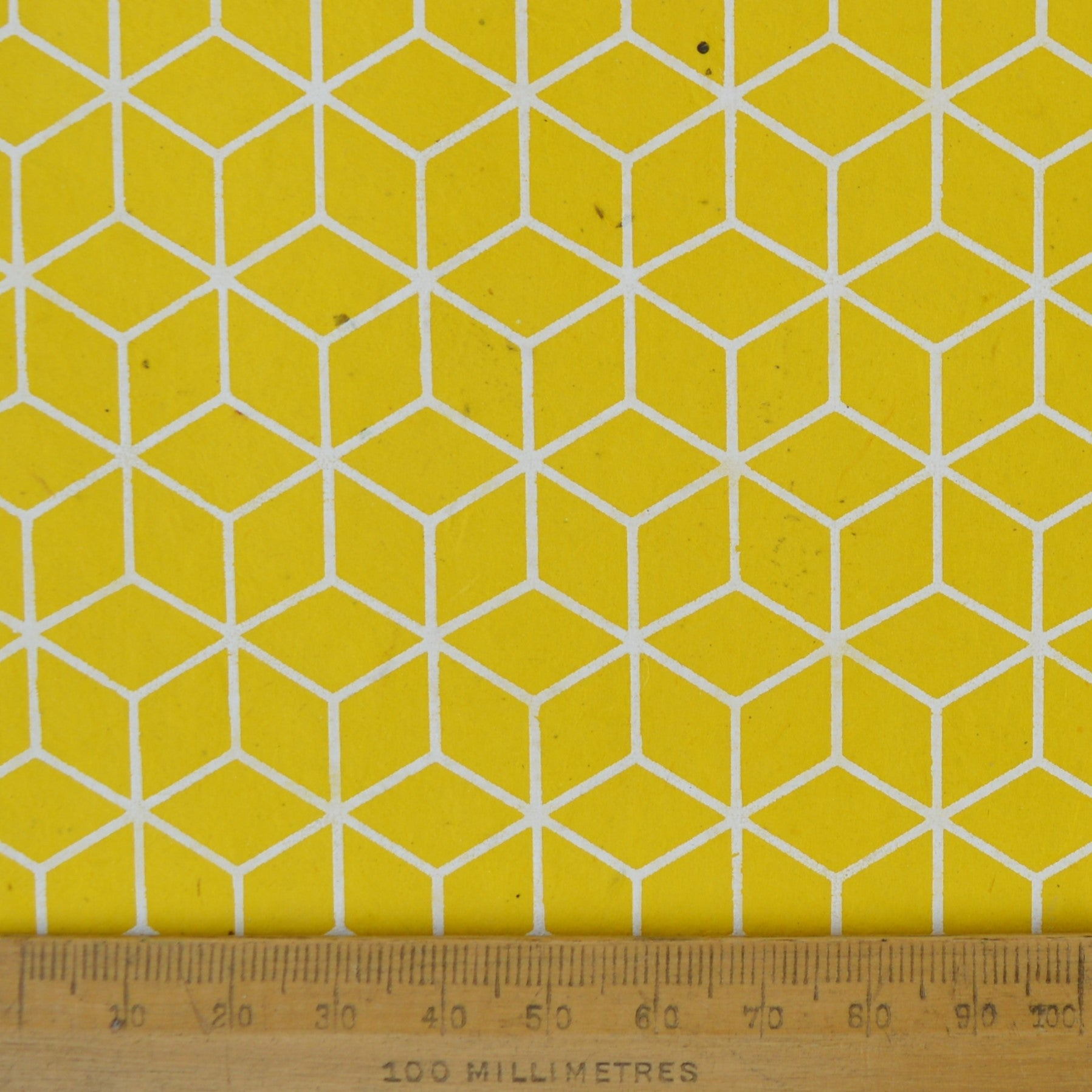 Munro and Kerr yellow geometric hand printed paper for a lampshade
