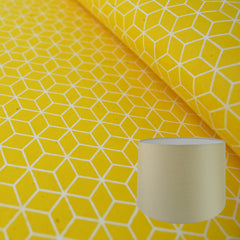 Munro and Kerr yellow geometric hand printed paper for a tapered drum lampshade