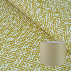 Munro and Kerr yellow printed Esme Winter paper for a tapered drum lampshade