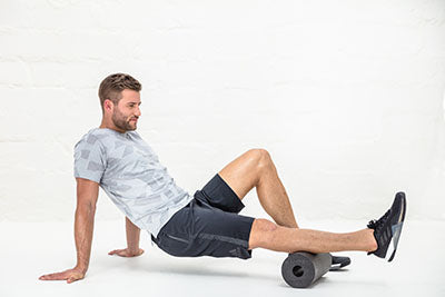 Man rolling out his charley horse and calf with the BLACKROLL Pro Foam Roller