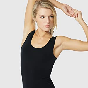 A female model posing after wearing Boody's tank top in black color