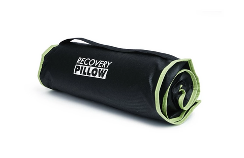 BLACKROLL Recovery Pillow rolled up for travel use.