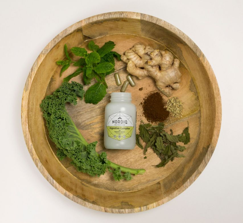 NORDIQ Nutrition Digestive Complex surrounded by ginger, spinach and kale