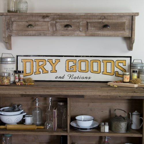 Vintage Embossed Metal Dry Goods & Notions Sign