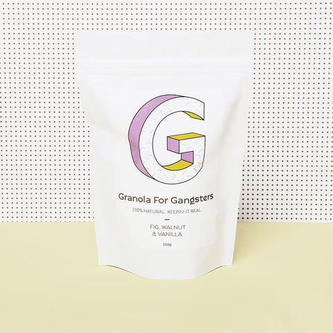 Bag of Granola for Gangsters fig, walnut and vanilla  on yellow table