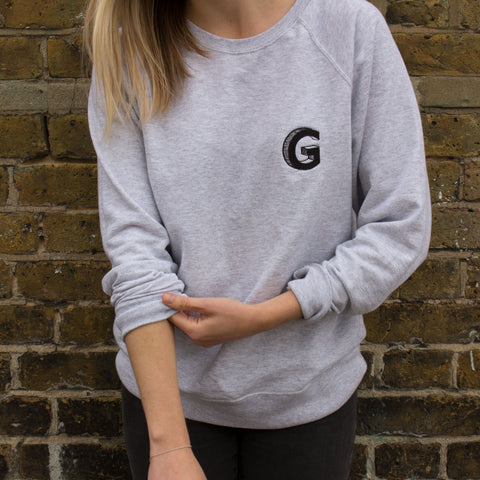 Woman in grey Granola for Gangsters sweater