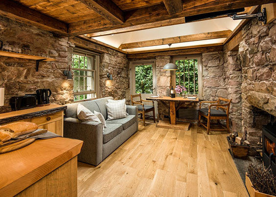 exposed stone walls in living room