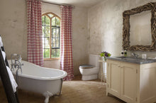 red checked curtains and roll top bath