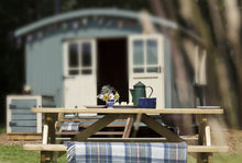 picnic bench and shepherds hut