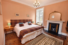 Open fire in bedroom at Cardhu House