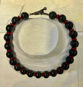 Jaded Jewels, 18 mm black agate  and red glass rondelles. $465.00