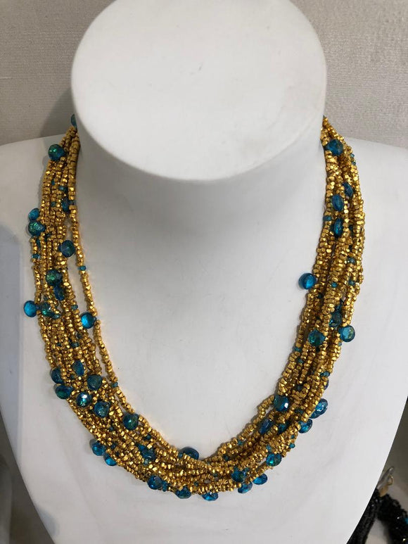 Jaded jewels,10 strand  gold nugget and sky blu topaz  necklace  $1325.00