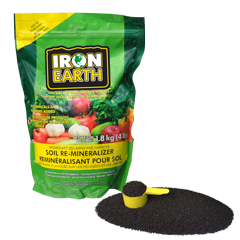 A picture of the 4lb bag of IRON EARTH™ alongside a measuring spoon.