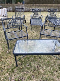 2 metal chairs and table