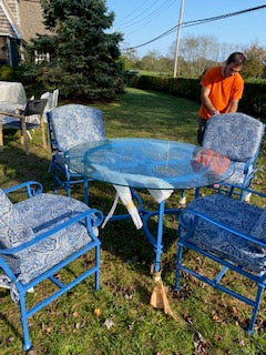 Blue outdoor table with four chairs