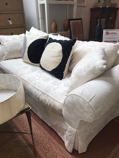 White rolled arm couch