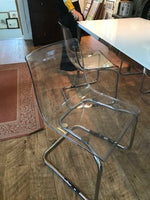 Set of four lucite chairs