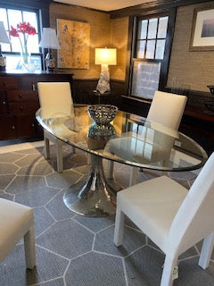 Oval Glass dining table with Silver base  Mecox