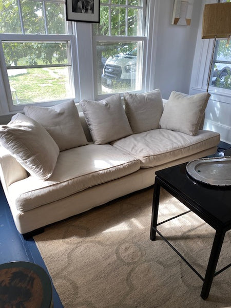 Cream sofa with throw pillows
