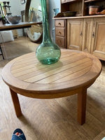 small round wood coffee table
