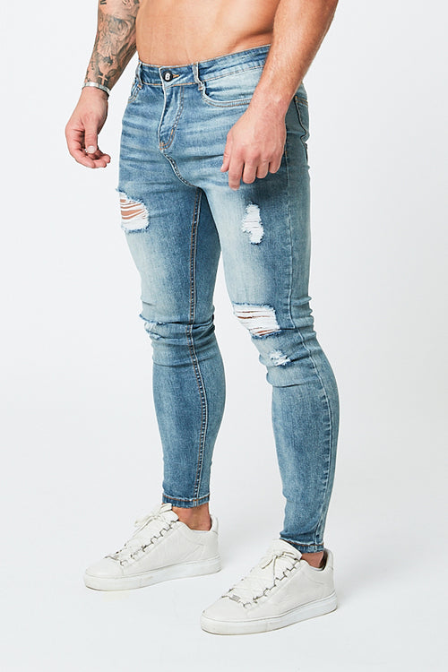SKINNY RIPPED-REPAIRED JEANS - PALE BLUE