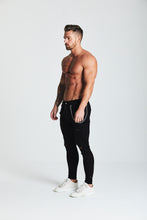 SKINNY FIT RIPPED-REPAIRED JEANS - BLACK