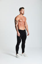 SKINNY RIPPED-REPAIRED JEANS - BLACK